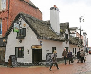 The historic 17th century Horse and Jockey pub, with a thatched roof, in Wrexham, Wales