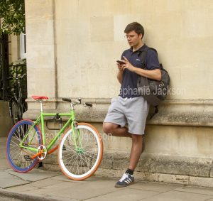 Young man using a phone in Oxford, England.