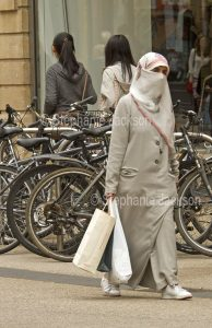 Muslim woman wearing a niqab in Oxford, England