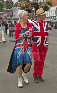 Patriotic man and women wearing clothing made from the British flag, the union jack, at Whitby in Yorkshire, England.