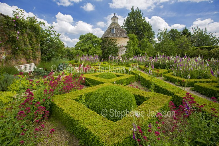 Garden with yew hedges in geometric design at Rousham gardens near Oxford, England.