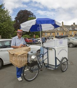 Ice cream seller with bicycle cart at Stow-on-the-wold in England.