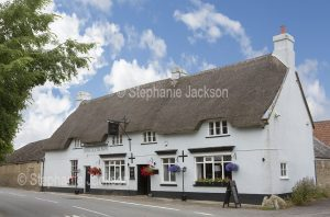 The Rose and Crown, a pub with a thatched roof, in the village of Longburton, Dorset, England.