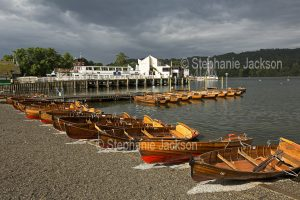 Rowing boats for hire on the bank of Lake Windemere, in the town of Windemere in the English Lake District in Cumbria.