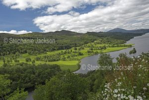 Scottish landscape, Loch Tummel, an extensive lake hemmed by woodlands and fields of wildflowers, viewed from the Queen's View lookout near Pitlochry In Scotland.
