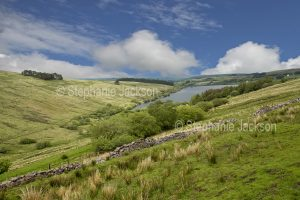 Reservoir / lake and rural landscape viewed from the Cwe Tawe Pass in Wales.