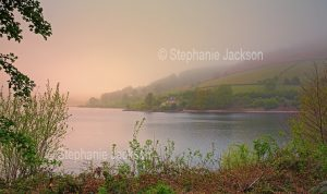 Landscape, A misty morning over the calm waters of the lake at Ladybower reservoir in the Upper Derwent Valley, in Derbyshire, England
