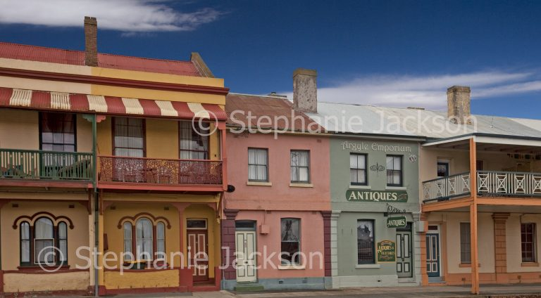 Row of colourful terrace houses in city of Goulburn in NSW Australia