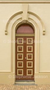 Ornate door and arched entrance to historic building / old courthouse, in village of Carcoar in NSW Australia