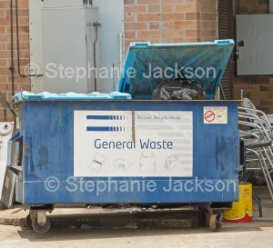 Rubbish, waste, in skip bin in city in Australia