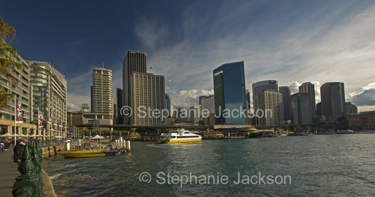 Skyscrapers of city of Sydney rising beside waters of Circular Quay and Sydney harbour, in NSW Australia