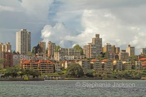 Highrise apartment buildings beside harbour in city of Sydney NSW Australia