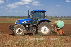 Tractor working in a field on an Australian farm