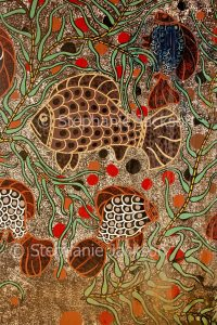 Australian aboriginal art / painting depicting fish and water plants, on support of bridge at Dubbo, NSW Australia