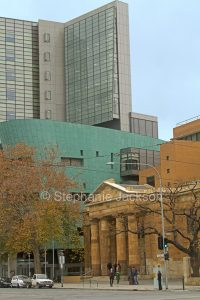 Historic and modern buildings stand side by side in the city of Adelaide, South Australia.