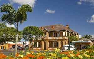 Historic building, old bank and gardens in the main street, Bourbong Street, in the city of Bundaberg in Queensland Australia