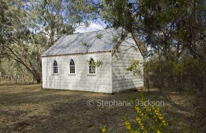 Old church with walls of decorative embossed metal panels at rural town of Glen Alice in NSW Australia