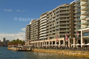 High rise waterfront apartment buildings beside waters of Circular Quay and Sydney harbour, in NSW Australia