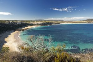 Coastal landscape with cliffs, secluded bay, sandy beach and turquoise waters of ocean on Eyre Peninsula South Australia