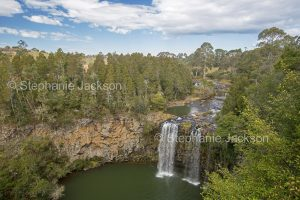 The Bielsdown River flows over rocks at Dangar Falls near the town of Dorrigo in northern NSW Australia.