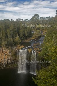 The Bielsdown River flows over rocks at Dangars Falls near the town of Dorrigo in northern NSW Australia.