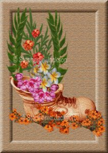 Floral art design. Pink, white and orange flowers in old boot on light brown background.
