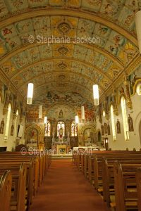 Interior of St. Mary's catholic church, with its ornate painted ceiling, at Bairnsdale in Victoria Australia.