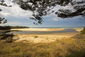 Coastal landscape with Lake Cathie separated from the Pacific Ocean by sandy beaches in NSW Australia