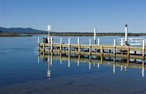 Jetty and Mallacoota inlet, a coastal estuary, hemmed by ranges in Victoria Australia