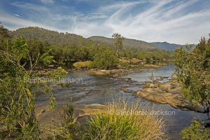 The Mann River, hemmed by forests, in northern NSW Australia.