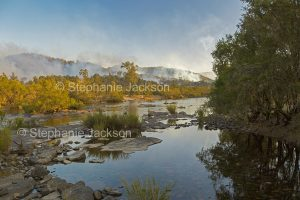 The Mann River in northern NSW Australia. A peaceful scene as a bushfire rages in the adjacent forests