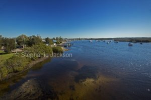 The Myall River beside the town of Tea Gardens near the river's wide estuary in NSW Australia