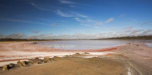 Panoramic view of vast expanse of pink salt and water of Lake Crozier, a salt lake in Murray Sunset National Park in outback Victoria Australia