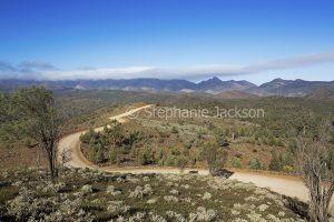 Dirt track / ridgeback road winding through hills of Flinders Ranges National Park in outback / northern South Australia