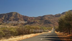 Bitumen road, Larapinta Drive, in the West MacDonnell Ranges, in the outback, Northern Territory, Central Australia.