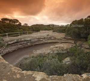 Massive sinkhole surrounded by woodlands in Coffin Bay National Park, near Port Lincoln on Eyre Peninsula South Australia