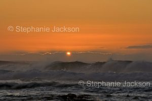 Sunrise over the waves of the Pacific Ocean near Moruya in NSW Australia.