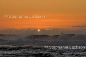 Sunrise over the waves of the Pacific Ocean near Moruya in NSW Australia.