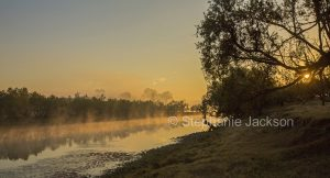 Sunrise on a misty morning at the Clarence River at Lilydale in northern NSW Australia