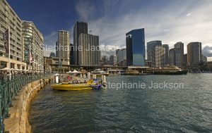 Skyscrapers of city of Sydney rising beside waters of Circular Quay and harbour, NSW Australia