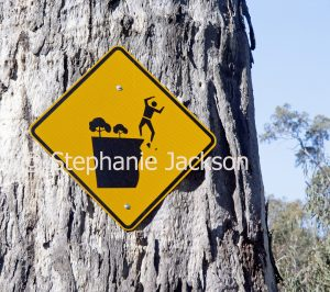 Sign showing the danger posed by crumbling cliffs.
