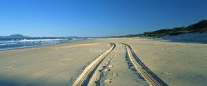 Panoramic view of tracks on deserted Australian beach in NSW Australia