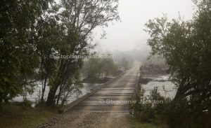 Wooden bridge and Mann River enveloped in morning mist at Cangai in northern NSW Australia.