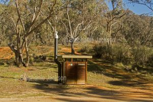 Long drop / pit toilet / dunny at rural bush camping area near Jindabyne in the Snowy Mountains region of NSW Australia.