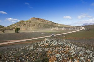 Road through treeless rocky landscape in the Flinders Ranges National Park in outback South Australia
