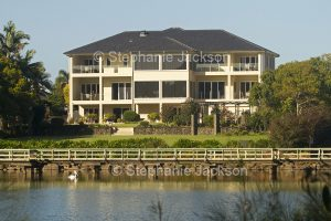 Modern waterfront mansion beside a lake in the city of Bundaberg in Queensland Australia