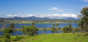 Panoramic landscape of Lake Awoonga at the foot of forested peaks of the Great Dividing Range near Gladstone, Queensland Australia.