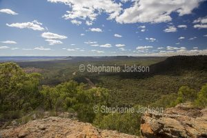 View from high lookout of forested Arcadia Valley hemmed by ranges , in central Queensland Australia.