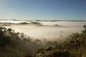 Early morning mist in valleys of the Great Dividing Range near Hill End in NSW Australia.