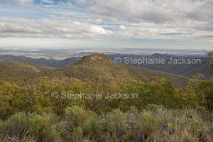 Vast landscape of forested ranges / rolling hills at Mount Kaputar National Park in NSW Australia